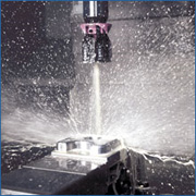 Rinse workpieces and fixtures by using internal coolant with the spindle stopped